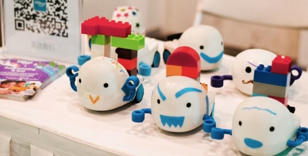 Behind its cute smile, the Plobot teaches tykes to program